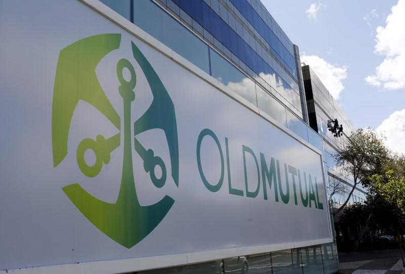 Workers clean windows outside the Cape Town headquarters of Anglo-South African financial services company Old Mutual