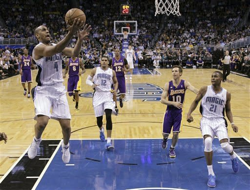 Orlando Magic's Arron Afflalo (4) makes a basket on a fast break in front of Los Angeles Lakers' Dwight Howard (12) and Steve Nash (10) during the first half of an NBA basketball game, Tuesday, March 12, 2013, in Orlando, Fla. (AP Photo/John Raoux)