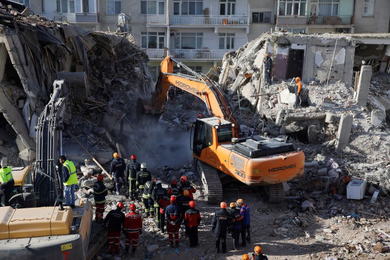 Search and rescue personnel work at the site of a collapsed building, after an earthquake in Elazig