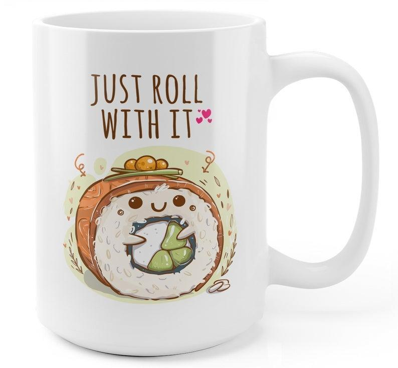 """<h2>shipitify Just Roll With It Sushi Coffee Mug</h2><br>Sushi lovers, rejoice! There's a food-related punny mug crafted just for you. <br><br><strong>shipitify</strong> Just Roll With It Sushi Coffee Mug, $, available at <a href=""""https://go.skimresources.com/?id=30283X879131&url=https%3A%2F%2Ffave.co%2F3rhdeuj"""" rel=""""nofollow noopener"""" target=""""_blank"""" data-ylk=""""slk:Etsy"""" class=""""link rapid-noclick-resp"""">Etsy</a>"""