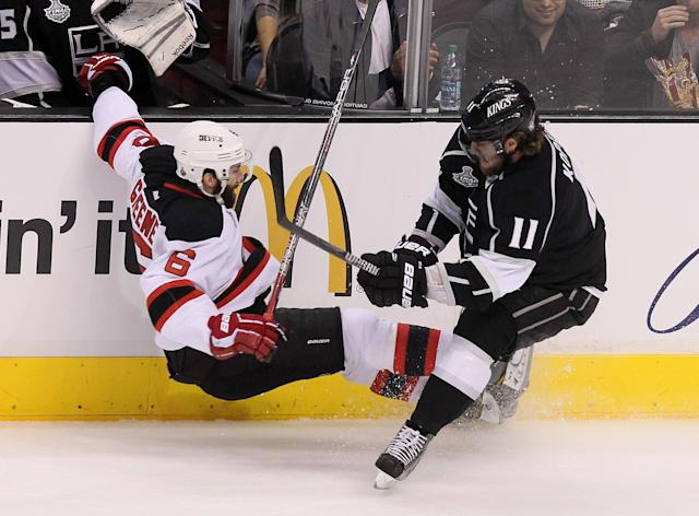 LOS ANGELES, CA - JUNE 11: Anze Kopitar #11 of the Los Angeles Kings and Andy Greene #6 of the New Jersey Devils collide near the side boards in the first period of Game Six of the 2012 Stanley Cup Final at Staples Center on June 11, 2012 in Los Angeles, California. (Photo by Jeff Gross/Getty Images)