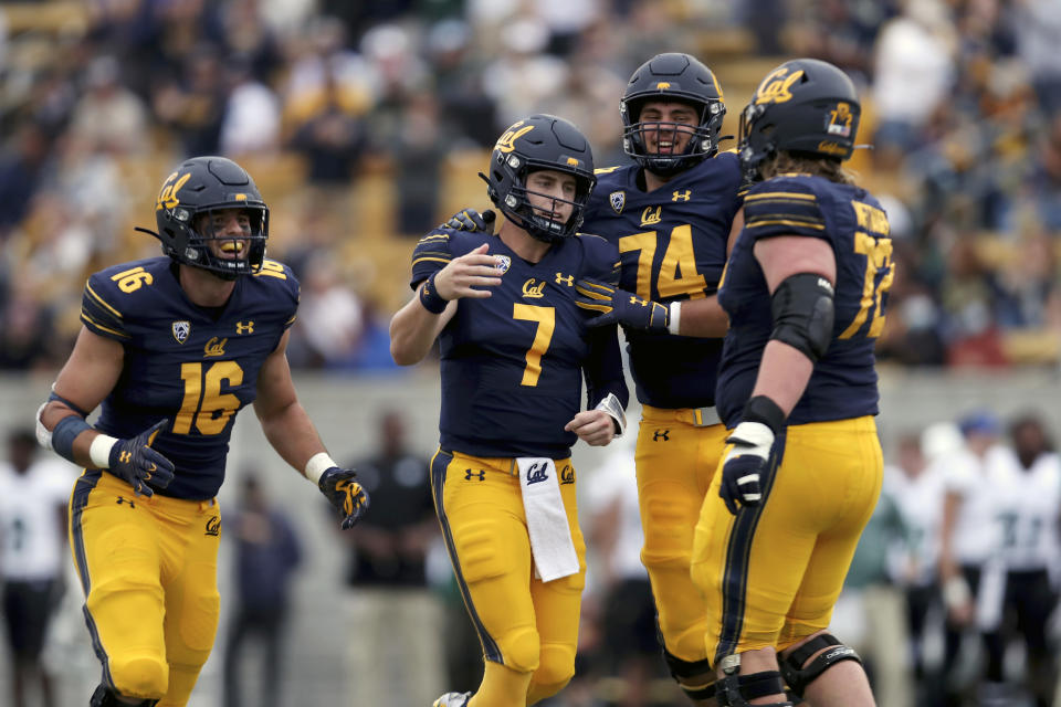 California quarterback Chase Garbers (7) is congratulated by teammates after throwing a touchdown pass against Sacramento State during the first half of an NCAA college football game on Saturday, Sept. 18, 2021, in Berkeley, Calif. (AP Photo/Jed Jacobsohn)