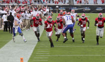Georgia defensive back Eric Stokes (27) returns an interception for a touchdown during the second quarter of a NCAA college football against Florida, Saturday, Nov. 7, 2020, in Jacksonville, Fla. (Curtis Compton/Atlanta Journal-Constitution via AP)