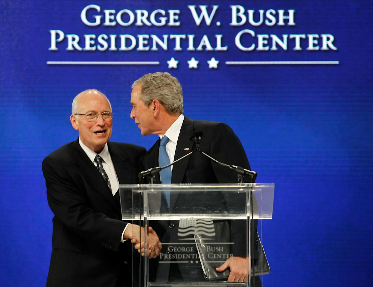 DALLAS - NOVEMBER 16:  Former U.S. Vice President Dick Cheney (L) introduces Former U.S. President George W. Bush during the George W. Bush Presidential Center groundbreaking ceremony on November 16, 2010 in Dallas, Texas. The George W. Bush Presidential Center is a state-of-the-art  250 million dollar complex that will include Former U.S. President George W. Bush's presidential library and museum, the George W. Bush Policy Institute, and the offices of the George W. Bush Foundation.  (Photo by Tom Pennington/Getty Images)