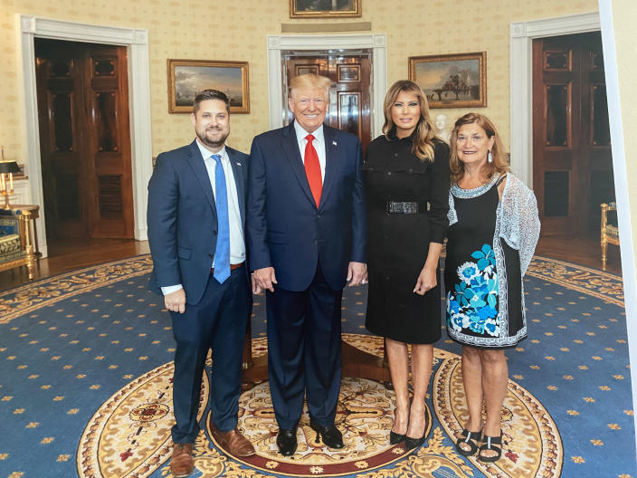Brett Eagleson and his mother, Gail Eagleson, with Donald and Melania Trump. (Brett Eagleson)