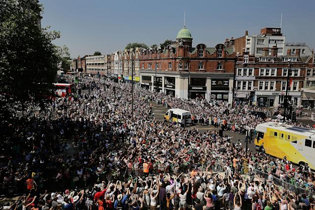 LONDON, ENGLAND - JULY 26: The Olympic Torch (bottom right) is carried through the crowd packed streets of central Brixton on July 26, 2012 in London, England. The Olympic flame is making its way through the capital on penultimate day of its journey around the UK before arriving in the Olympic Stadium on Friday evening for the Olympic games' Opening Ceremony. (Photo by Matthew Lloyd/Getty Images)