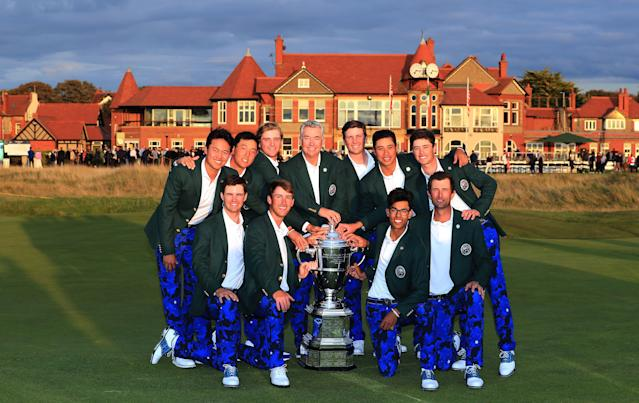 """<div class=""""caption""""> The victorious U.S. Walker Cup team poses with its prize on Sunday at Royal Liverpool after becoming the first road team to win the match since 2007. </div> <cite class=""""credit"""">David Cannon/Getty Images</cite>"""
