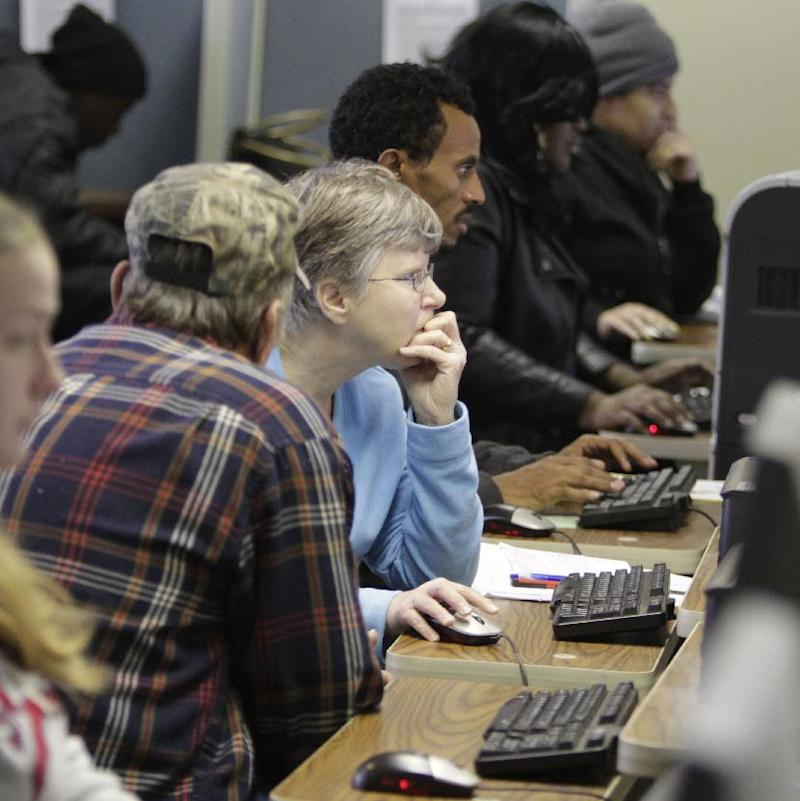 FILE-   In this file photo taken Jan. 7, 2011, unemployed workers use computers to search for jobs at the Virginia Employment Commission's Reemploy Virginia office in Mechanicsville, Va. The jobless rate is dipping, but millions of people are still out of work. And that could have implications when they file their income tax returns for 2011.    (AP Photo/Steve Helber, file)