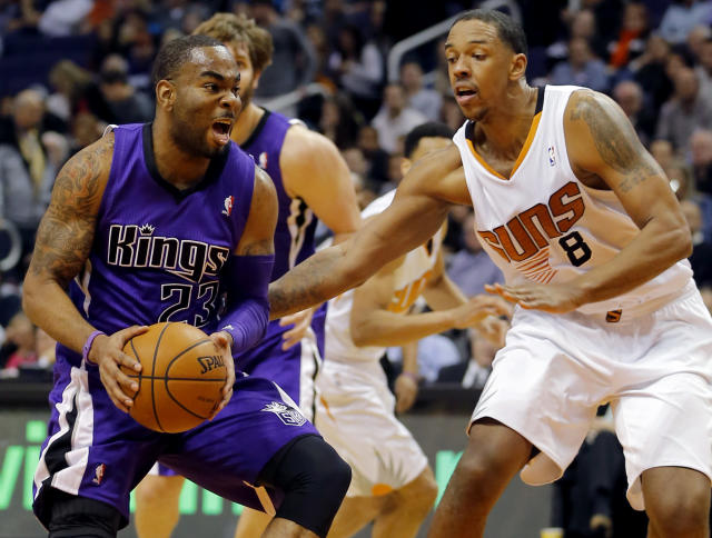 Sacramento Kings' Marcus Thompson (23) drives past Phoenix Suns' Channing Frye during the first half of an NBA basketball game on Friday, Dec. 13, 2013, in Phoenix. (AP Photo/Matt York)