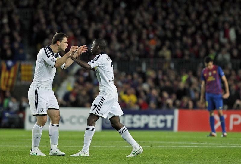Chelsea's Ramires from Brazil, second left, celebrates his goal with Branislav Ivanovic from Serbia, left, during a Champions League second leg semifinal soccer match against Barcelona at Camp Nou stadium, in Barcelona, Spain, Tuesday, April 24, 2012. Chelsea drew 2-2 with Barcelona to win the match 3-2 on aggregate. (AP Photo/Andres Kudacki)