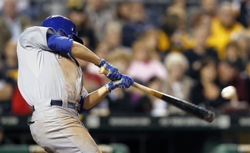 Chicago Cubs' David DeJesus hits a single to drive in Welington Castillo with the go-ahead run in the eighth inning of s baseball game against the Pittsburgh Pirates on Saturday, Sept. 8, 2012, in Pittsburgh. The Cubs won 4-3. (AP Photo/Keith Srakocic)