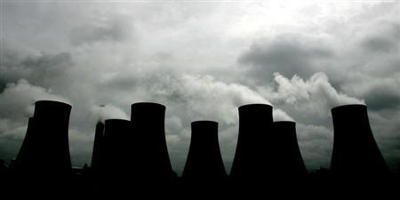 Smoke billows from cooling towers at the Radcliffe Power Station near Nottingham in central England.