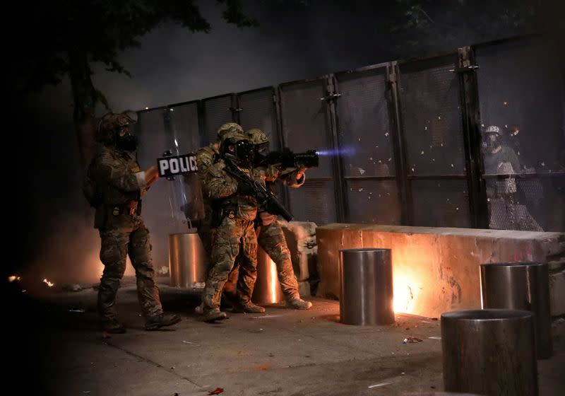 U.S. charges 18 Portland protesters as it sends tactical police to Seattle