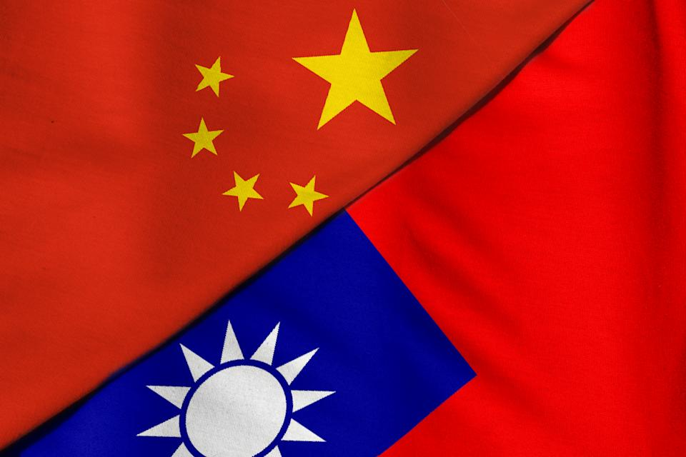 Two flags. People's Republic of China and Taiwan.