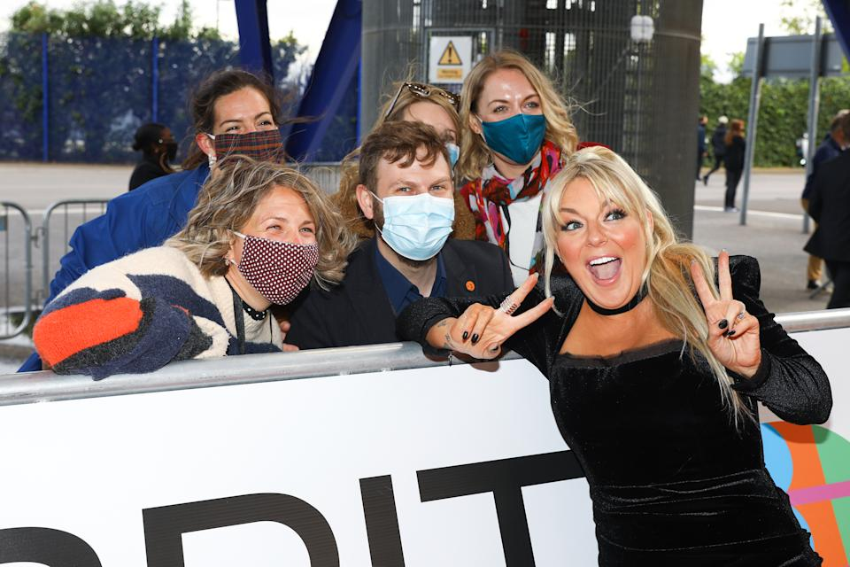 LONDON, ENGLAND - MAY 11: Sheridan Smith poses with fans as she arrives at The BRIT Awards 2021 at The O2 Arena on May 11, 2021 in London, England. (Photo by JMEnternational/JMEnternational for BRIT Awards/Getty Images)
