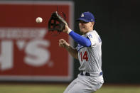 Los Angeles Dodgers second baseman Enrique Hernandez fields a grounder hit by Arizona Diamondbacks' Josh Rojas before throwing to first base for the out during the fourth inning of a baseball game Friday, Aug. 30, 2019, in Phoenix. (AP Photo/Ross D. Franklin)