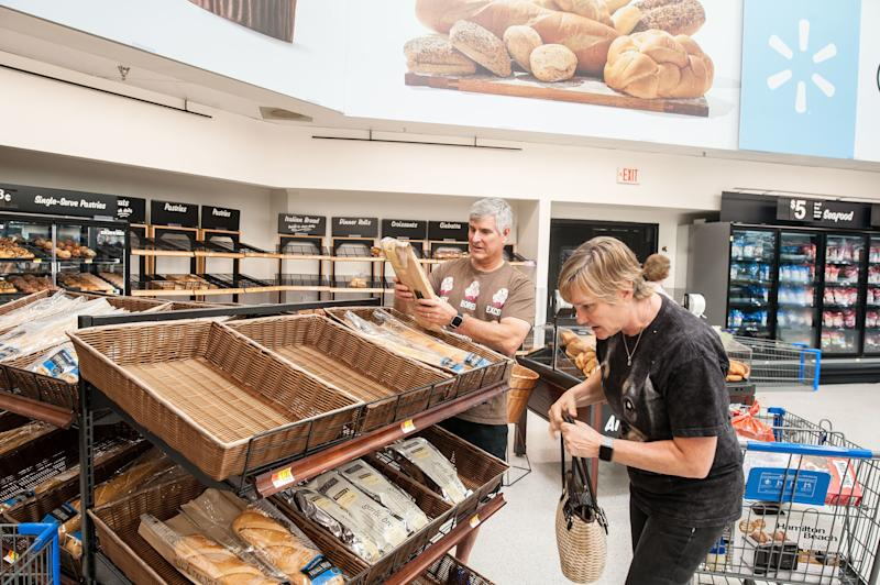 Don and Tammy Snowden, whose home just down the street from the Walmart in Katy, Texas, was flooded, pick up fresh-baked baguettes at the store. (Joseph Rushmore for HuffPost)