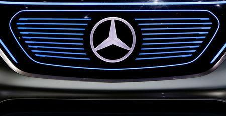 FILE PHOTO: The Mercedes star logo of an EQ concept car is pictured before the annual news conference of Daimler AG in Stuttgart, Germany, February 2, 2017. REUTERS/Michaela Rehle /File Photo