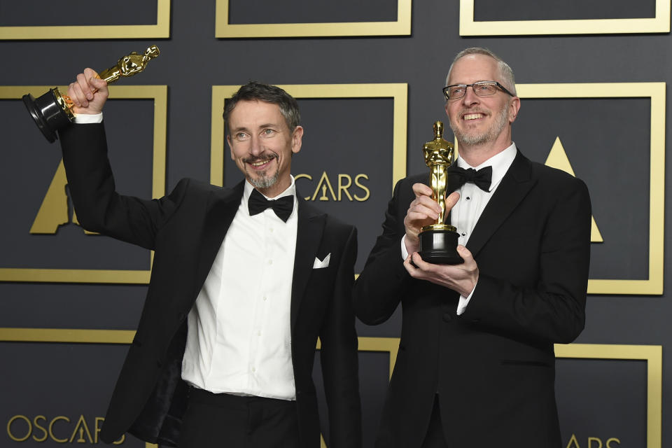 """Stuart Wilson, left, and Mark Taylor, winners of the award for best sound mixing for """"1917"""", pose in the press room at the Oscars on Sunday, Feb. 9, 2020, at the Dolby Theatre in Los Angeles. (Photo by Jordan Strauss/Invision/AP)"""