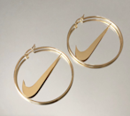 "<p><strong>Walk Like Her</strong></p><p>shopwalklikeher.com</p><p><strong>$32.99</strong></p><p><a href=""https://www.shopwalklikeher.com/product/nike-hoop-earrings-gold-swoosh-check-pre-order"" rel=""nofollow noopener"" target=""_blank"" data-ylk=""slk:Shop Now"" class=""link rapid-noclick-resp"">Shop Now</a></p><p>Just picture these paired-up with your favorite Champion hoodie and a <a href=""https://www.seventeen.com/fashion/trends/g33534514/best-nike-air-force-1-sneakers/"" rel=""nofollow noopener"" target=""_blank"" data-ylk=""slk:pair of Air Force 1s"" class=""link rapid-noclick-resp"">pair of Air Force 1s</a>. Yeah, I think you need them. </p>"