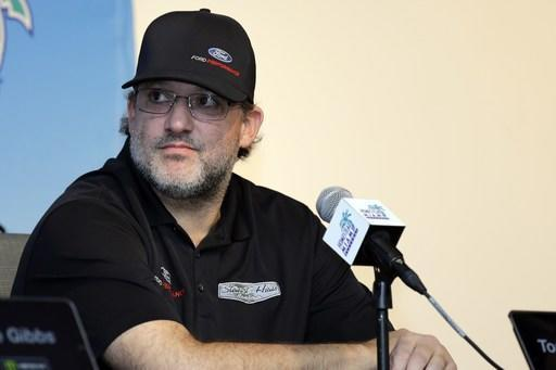 Tony Stewart, owner of Stewart-Haas Racing, listens during a news conference for the NASCAR Cup series auto race at the Homestead-Miami Speedway, Friday, Nov. 16, 2018, in Homstead, Fla. (AP Photo/Terry Renna)