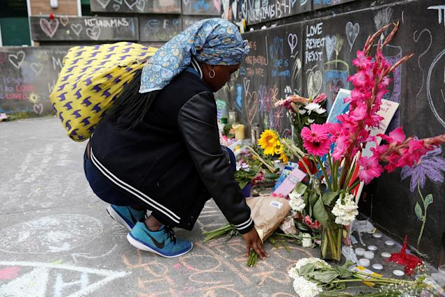 <p>A Muslim woman, who preferred not to giver her name, prays at a makeshift memorial for two men who were killed on a commuter train while trying to stop another man from harassing two young women who appeared to be Muslim, in Portland, Ore., May 29, 2017. (Terray Sylvester/Reuters) </p>
