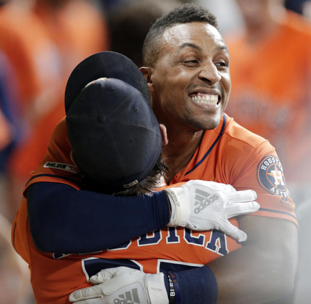 Houston Astros Tony Kemp, right, is hugged by Josh Reddick in the dugout after Kemp's two-run home run that tied the score during the fifth inning of the team's baseball game against the Baltimore Orioles on Friday, June 7, 2019, in Houston. (AP Photo/Michael Wyke)