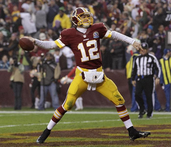 Washington Redskins quarterback Kirk Cousins spikes the ball after a two point conversion to tie the game and force overtime during the second half of an NFL football game against the Baltimore Ravens in Landover, Md., Sunday, Dec. 9, 2012. (AP Photo/Patrick Semansky)