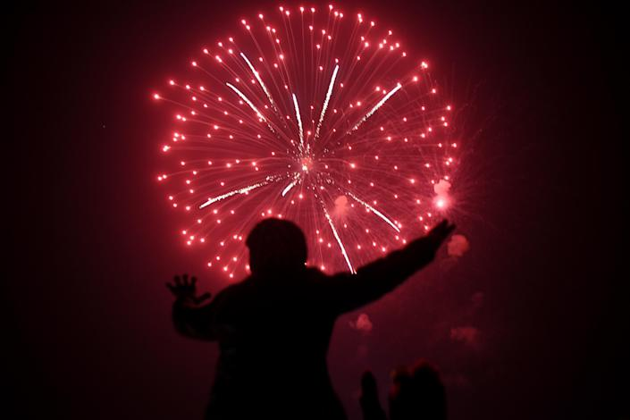 A Pakistani man watches the fireworks display during the New Year celebrations. (Photo: Asif HassanAFP/Getty Images)