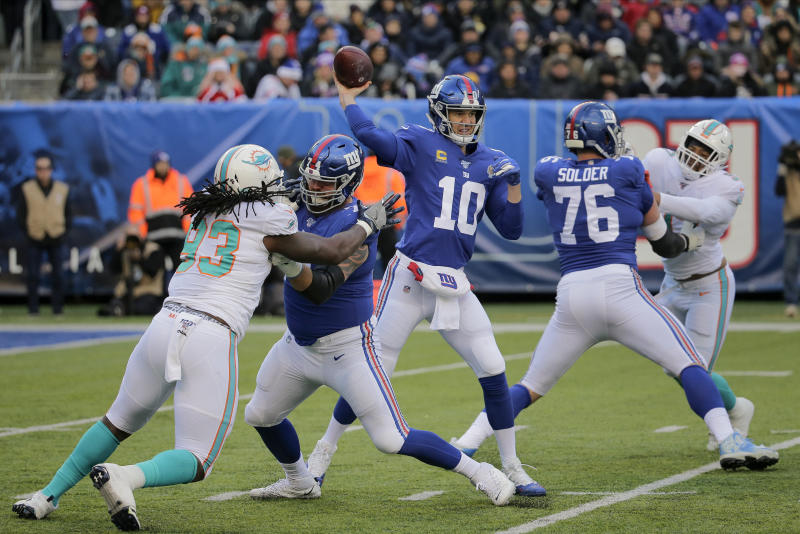 File-This Dec. 15, 2019, file photo shows New York Giants quarterback Eli Manning (10) passing against the Miami Dolphins during the second quarter of an NFL football game, in East Rutherford, N.J. The man who has been the face of the New York Giants since 2004 is probably going to make his final appearance this weekend. Manning's 16-year Giants' career that has included two Super Bowl titles likely will come to an end Sunday, Dec. 29, 2019, when New York tries to spoil the Philadelphia Eagles bid to win the NFC East. (AP Photo/Seth Wenig, File)