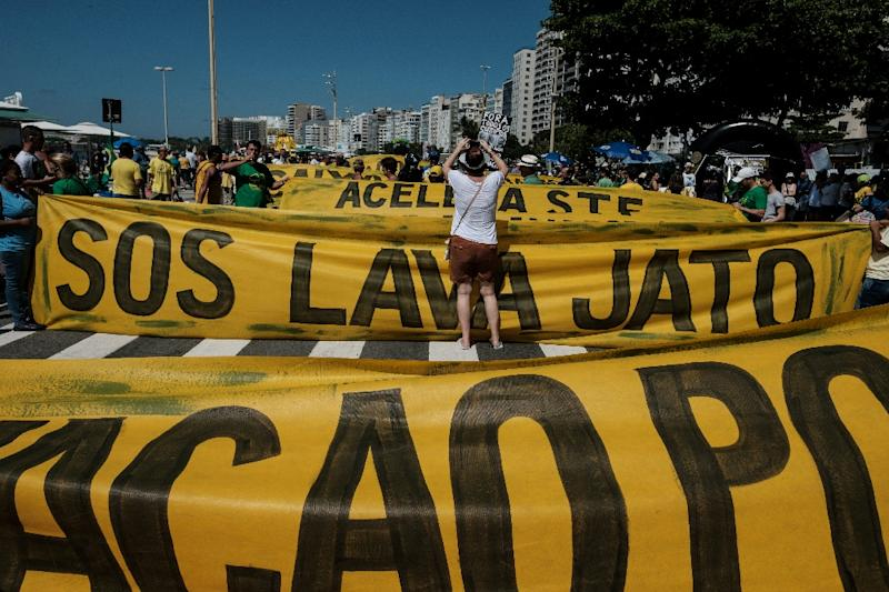 Demonstrators march along Copacabana Beach in Rio de Janeiro, Brazil, on March 26, 2017 during a nationwide protest against political corruption