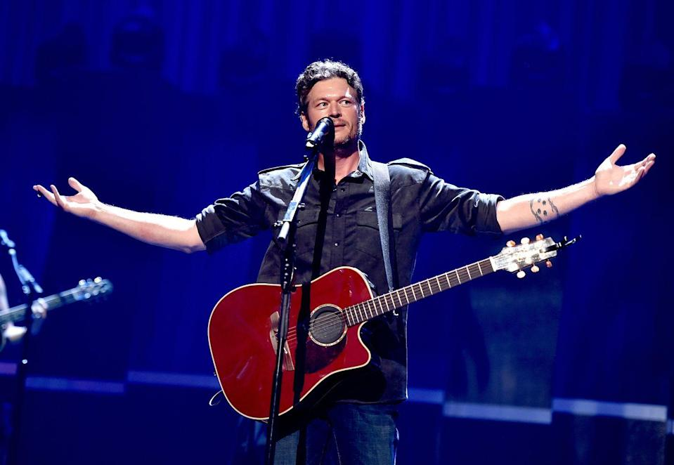 """<p>Blake Shelton will be the first person to say that he thinks the tattoo on his forearm sucks. <em>The Voice</em> star drew the design himself, <a href=""""https://www.cheatsheet.com/entertainment/blake-shelton-said-he-has-the-crappiest-tattoo-and-fans-get-it-wrong.html/"""" rel=""""nofollow noopener"""" target=""""_blank"""" data-ylk=""""slk:Showbiz Cheat Sheet"""" class=""""link rapid-noclick-resp"""">Showbiz Cheat Sheet</a> reports, and intended for it to two strings of barbed wire that encircle his arm with deer tracks in between. However, he (and fans also) think the tracks ended up looking more like ladybugs than what he intended. </p><p>But even though the Grammy nominee isn't a fan, his ink did lend itself to fiancé Gwen Stefani sharing a sweet moment on <a href=""""https://twitter.com/gwenstefani/status/848325866748731392"""" rel=""""nofollow noopener"""" target=""""_blank"""" data-ylk=""""slk:Twitter"""" class=""""link rapid-noclick-resp"""">Twitter</a> when her three sons all got temporary tattoos that matched Blake's. </p>"""
