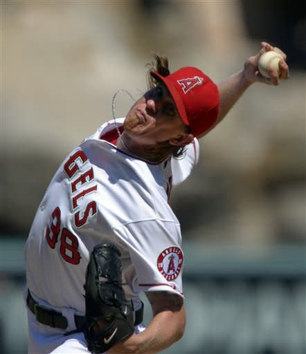 CORRECTS TO STARTING PITCHER JERED WEAVER, NOT RELIEF PITCHER BOBBY CASSEVAH - Los Angeles Angels starting pitcher Jered Weaver throws to the plate during the second inning of their baseball game against the Chicago White Sox, Sunday, Sept. 23, 2012, in Anaheim, Calif. (AP Photo/Mark J. Terrill)