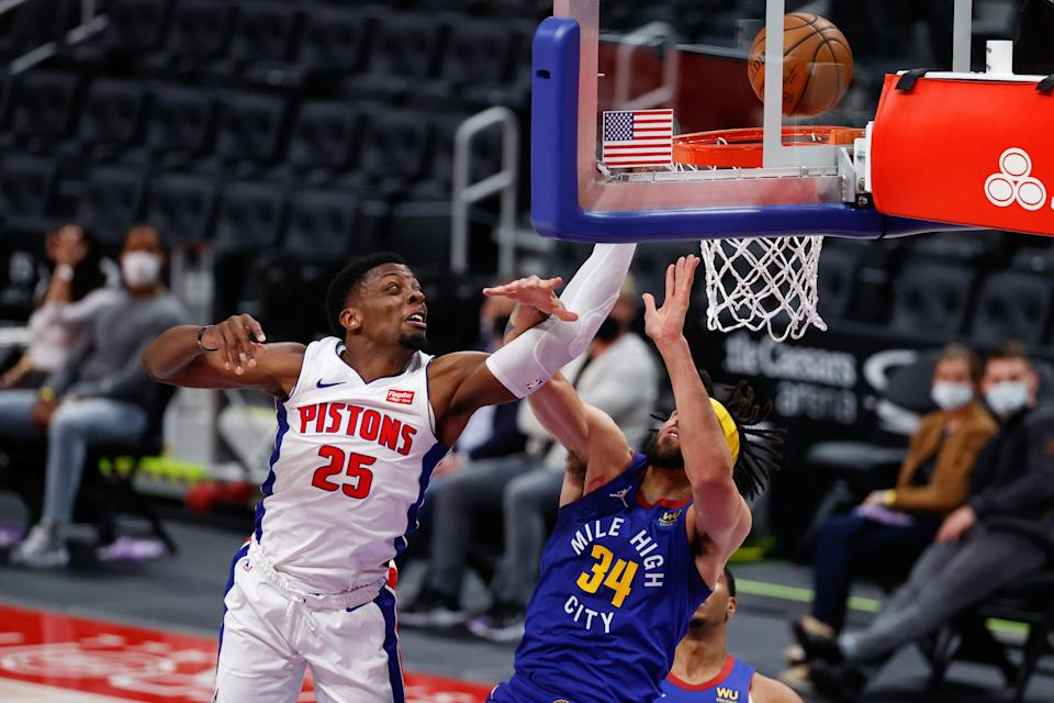 Detroit Pistons forward Tyler Cook is fouled by Denver Nuggets center JaVale McGee in the first half at Little Caesars Arena, May 14, 2021.
