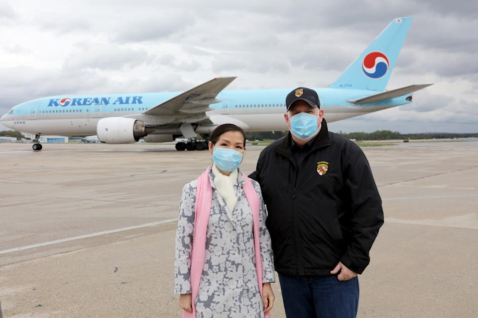 Governor Hogan Holds a Press Conference along with his wife Yumi, after receiving COVID-19 test kits from South Korea at Baltimore/Washington International Thurgood Marshall Airport on April 18, 2020. (Steve Kwak/Office of the Governor via Flickr)