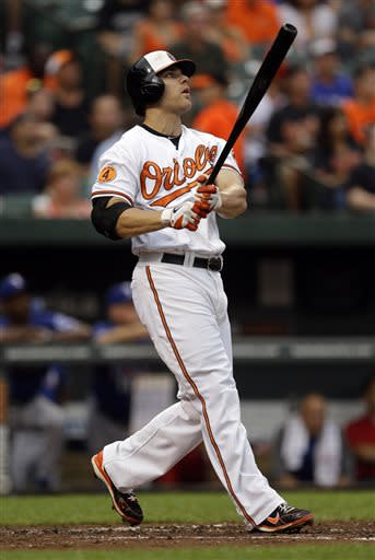 Baltimore Orioles' Chris Davis watches his solo home run in the second inning of a baseball game against the Texas Rangers, Thursday, July 11, 2013, in Baltimore. (AP Photo/Patrick Semansky)
