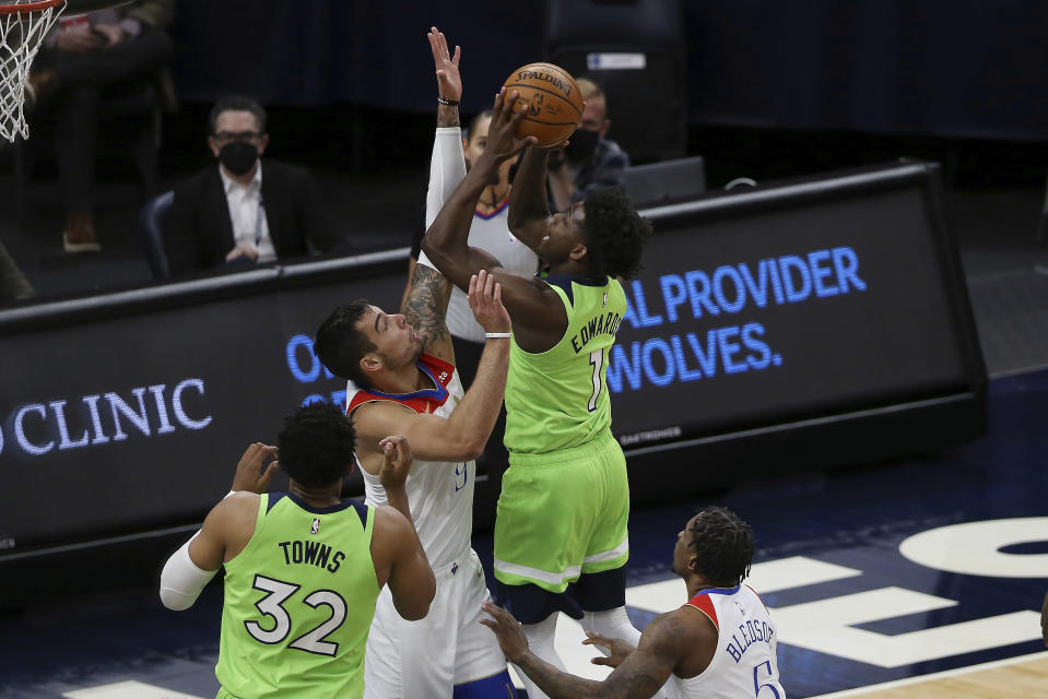 Minnesota Timberwolves' Anthony Edwards (1) shoots against New Orleans Pelicans' Willy Hernangomez (9) during the first half of an NBA basketball game Saturday, May 1, 2021, in Minneapolis. (AP Photo/Stacy Bengs)