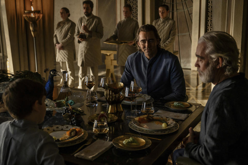 """This image released by Apple TV+ shows Cooper Carter, from left, Lee Pace and Terrence Mann i in """"Foundation,"""" premiering Sept. 24, 2021. (Apple TV+ via AP)"""