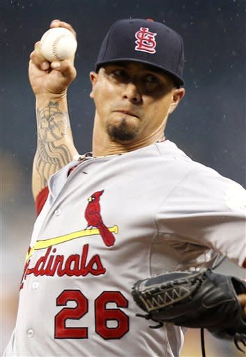 St. Louis Cardinals starting pitcher Kyle Lohse throws against the Pittsburgh Pirates in the second inning of the baseball game on Monday, Aug. 27, 2012, in Pittsburgh. (AP Photo/Keith Srakocic)