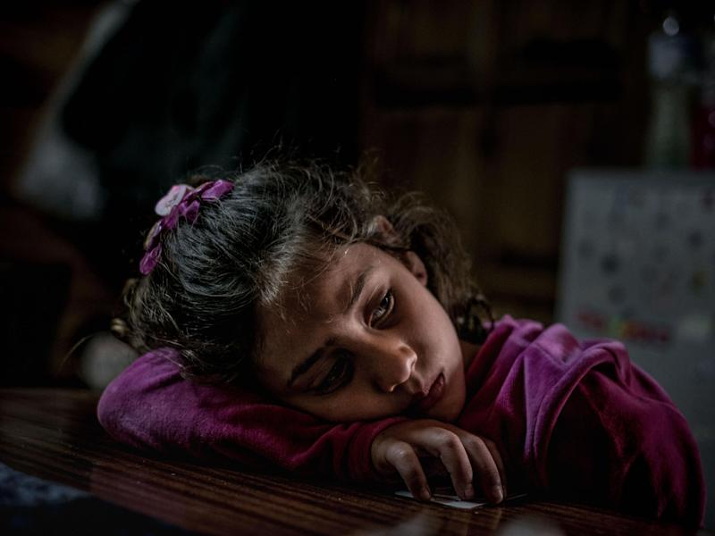 Mariem, 8, a refugee from the Syrian Arab Republic, in her family's shelter at an open refugee camp run by volunteers in Lesvos, Greece: Unicef
