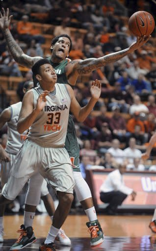 Miami's Julian Gamble, rear, grabs a rebound against Virginia Tech's Marshall Wood (33) during the first half of an NCAA college basketball game Wednesday, Jan. 30, 2013, at Cassell Coliseum in Blacksburg, Va. (AP Photo/Don Petersen)