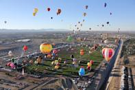 """<p>Wake up early to watch nearly 750 colorful balloons launch en masse at the <a href=""""https://balloonfiesta.com/"""" rel=""""nofollow noopener"""" target=""""_blank"""" data-ylk=""""slk:Albuquerque International Balloon Fiesta"""" class=""""link rapid-noclick-resp"""">Albuquerque International Balloon Fiesta</a> (Oct. 2-10), one the largest balloon festivals in the world. You don't have to be just a spectator: Reserve a <a href=""""https://www.rainbowryders.com/locations/albuquerque/"""" rel=""""nofollow noopener"""" target=""""_blank"""" data-ylk=""""slk:sunrise or sunset ride"""" class=""""link rapid-noclick-resp"""">sunrise or sunset ride</a> with a celebratory champagne toast at the end. </p>"""