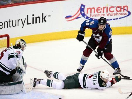 Colorado Avalanche center Ryan O'Reilly (90) attempts on a shot on Minnesota Wild goalie Darcy Kuemper (35) as defenseman Marco Scandella (6) falls in the second period in game seven of the first round of the 2014 Stanley Cup Playoffs at Pepsi Center. Apr 30, 2014; Denver, USA; Ron Chenoy-USA TODAY Sports -