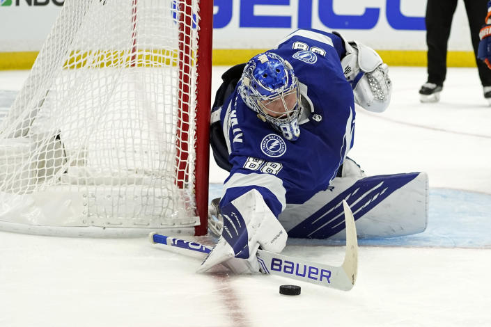 Tampa Bay Lightning goaltender Andrei Vasilevskiy makes a save on a shot by the New York Islanders during the third period in Game 7 of an NHL hockey Stanley Cup semifinal playoff series Friday, June 25, 2021, in Tampa, Fla. (AP Photo/Chris O'Meara)