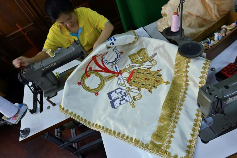 Seamstresses at the Praharuthai Convent in Bangkok are working hard ahead of the trip to ensure Pope Francis and his bishops, deacons and priests are decked out in the country's finest threads (AFP Photo/Romeo GACAD)