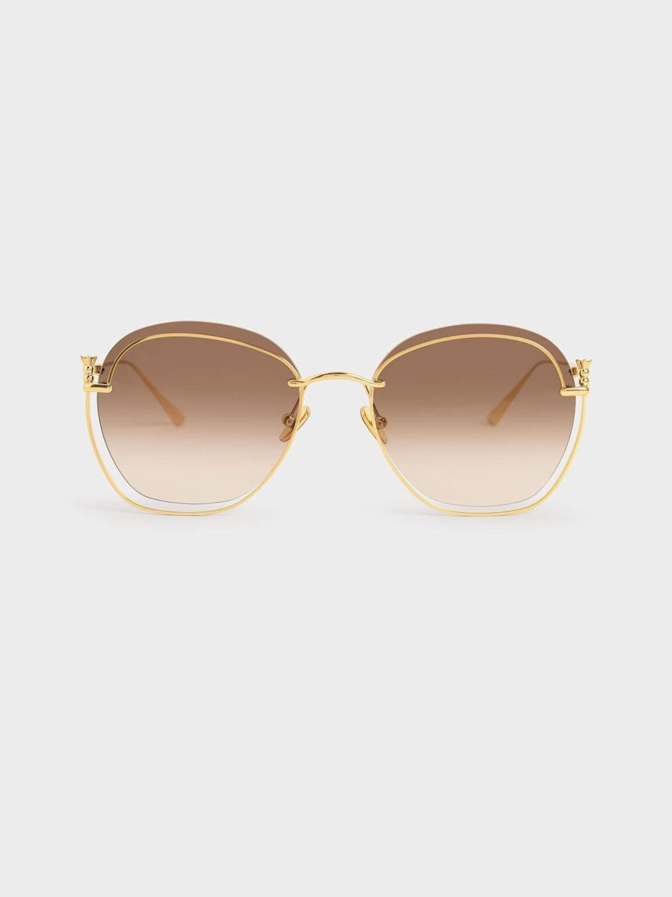 <p><span>Charles &amp; Keith Gold Cutout Butterfly Sunglasses</span> ($59)</p>