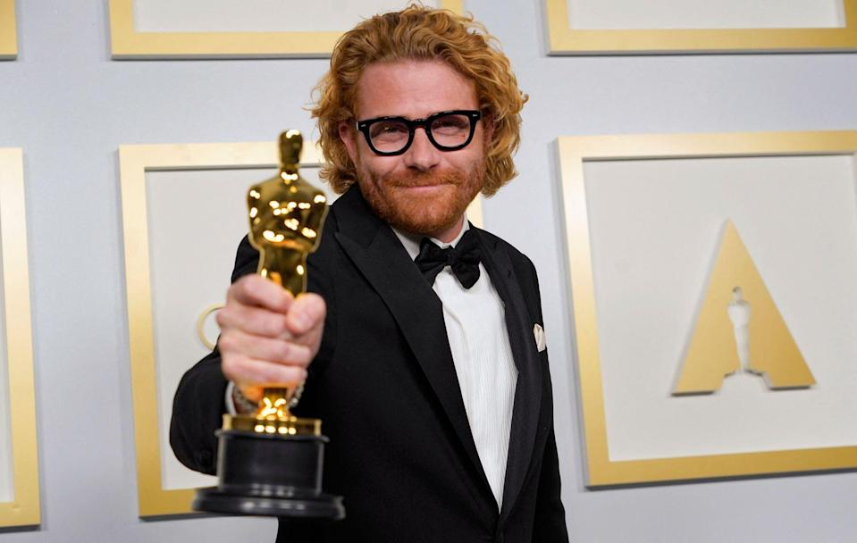 Erik Messerschmidt with the award for Best Cinematography for 'Mank'AFP/Getty