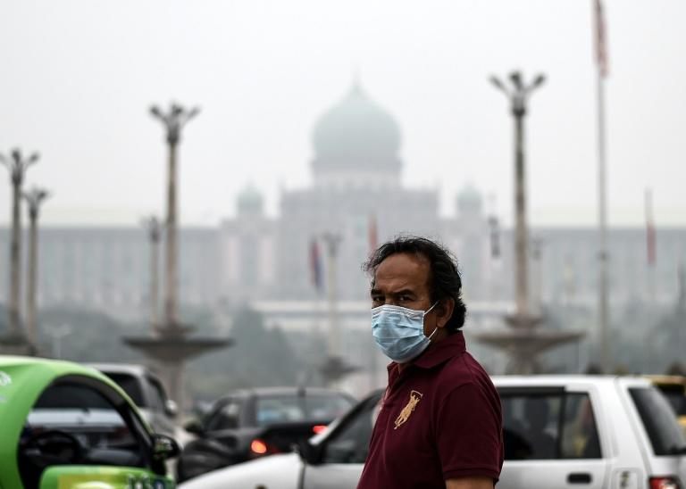 A man wears a face mask due to the haze in Putrajaya, Malaysia, on September 13, 2015