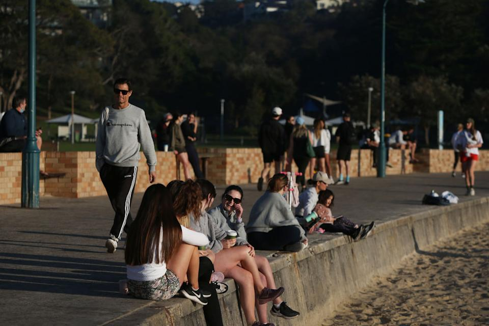 People relax and exercise at Bronte Beach in Sydney, Australia.