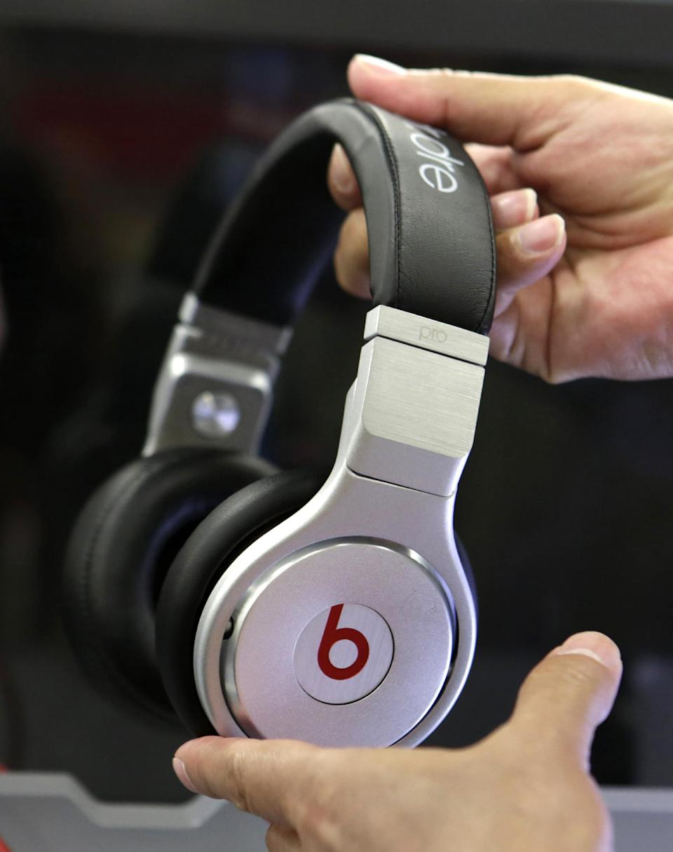 FILE - In a May 29, 2014 file photo, a customer holds a pair a beats headphones at a Best Buy store in Hialeah, Fla. Ohio native, Buckeyes fan and Cleveland Cavaliers star LeBron James helped each of the Buckeyes, who play Oregon on Jan. 12, 2015, get a pair of Beats By Dre headphones. A message was posted on Ohio State coach Urban Meyer's Twitter account on Saturday, thanking James for the headphones. Ohio State officials say that the gift was not a violation of improper benefits to athletes. (AP Photo/Alan Diaz, File)